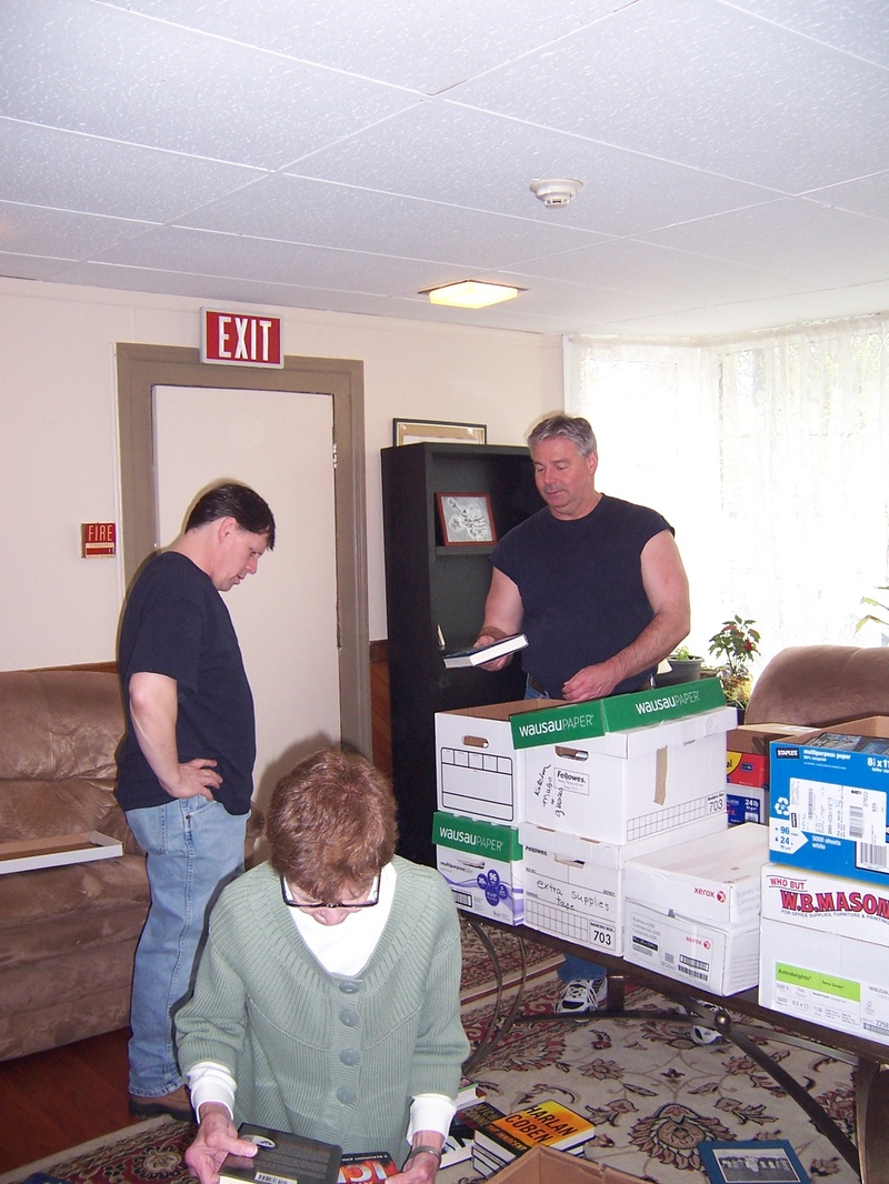 Residents Stan & Steve with Ellen sorting books